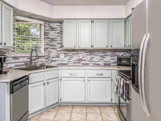 Fully stocked kitchen with Keurig coffee maker