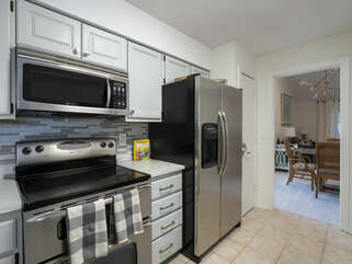 Kitchen is adjacent to dining area