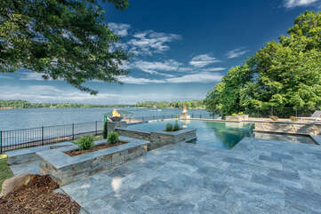 Gorgeous views from this luxurious pool complete with tanning deck in shallow water! Also perfect for little to sit and play!