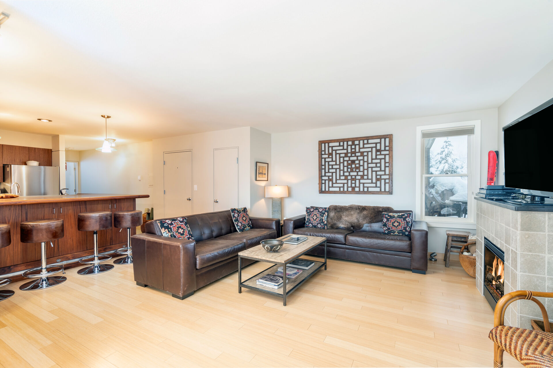 Living room with two couches and tv at this Telluride condo for rent.