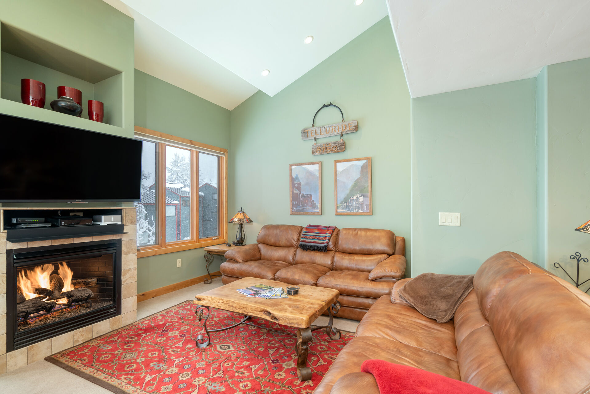 The leather couches, fireplace, and flat-screen TV of this 2 bedroom condo in Telluride.