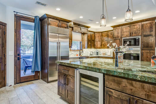 Large Center Island with a Wine Fridge and Plenty of Prep or Entertaining Space