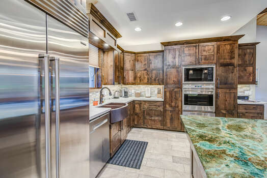 Fully Equipped Chef's Kitchen with Double Ovens and a SubZero Refrigerator