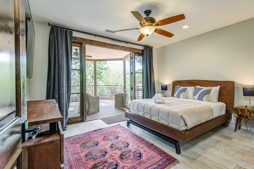 Master Bedroom with Queen Bed, 65'' Smart TV, and a Private Bath