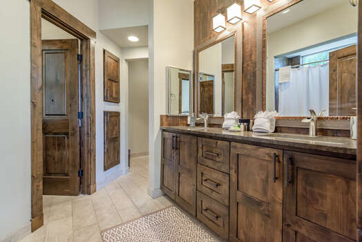 Master Bath with Double Vanity Sinks, Water Closet, and Tile Floors