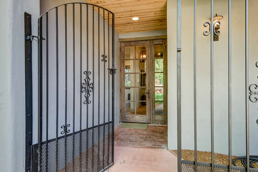 Front Gate and Entryway with Large Onyx Stone
