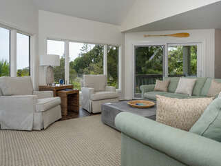 Wonderful open floor plan with swivel chairs so all seats have beautiful view of the marsh.