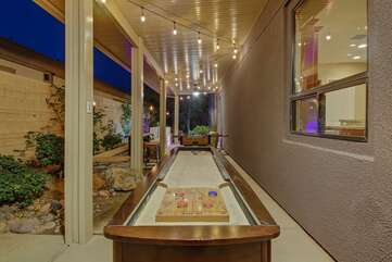 Simply remove the long table top to play a game of Shuffleboard
