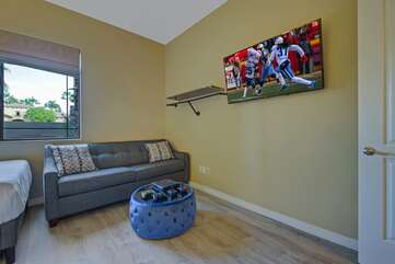This Bedroom six doubles as Den with large TV, couch, coffee table and Xbox gaming area