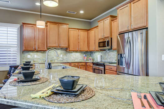 Spacious Kitchen with Granite Countertops and Bar Seating