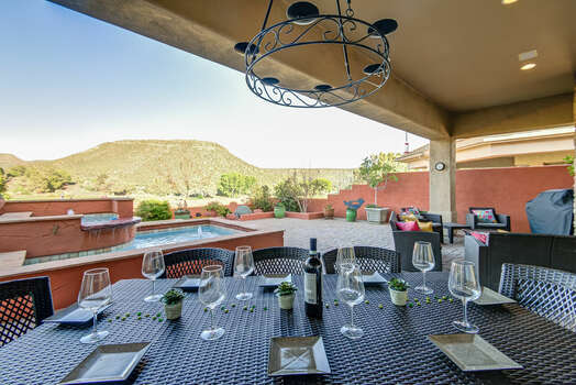 Experience Dining with a Peaceful Water Fountain and Red Rock Views