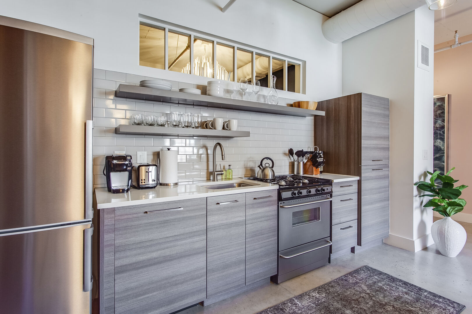Modern Kitchen Includes Stainless Steel Appliances.