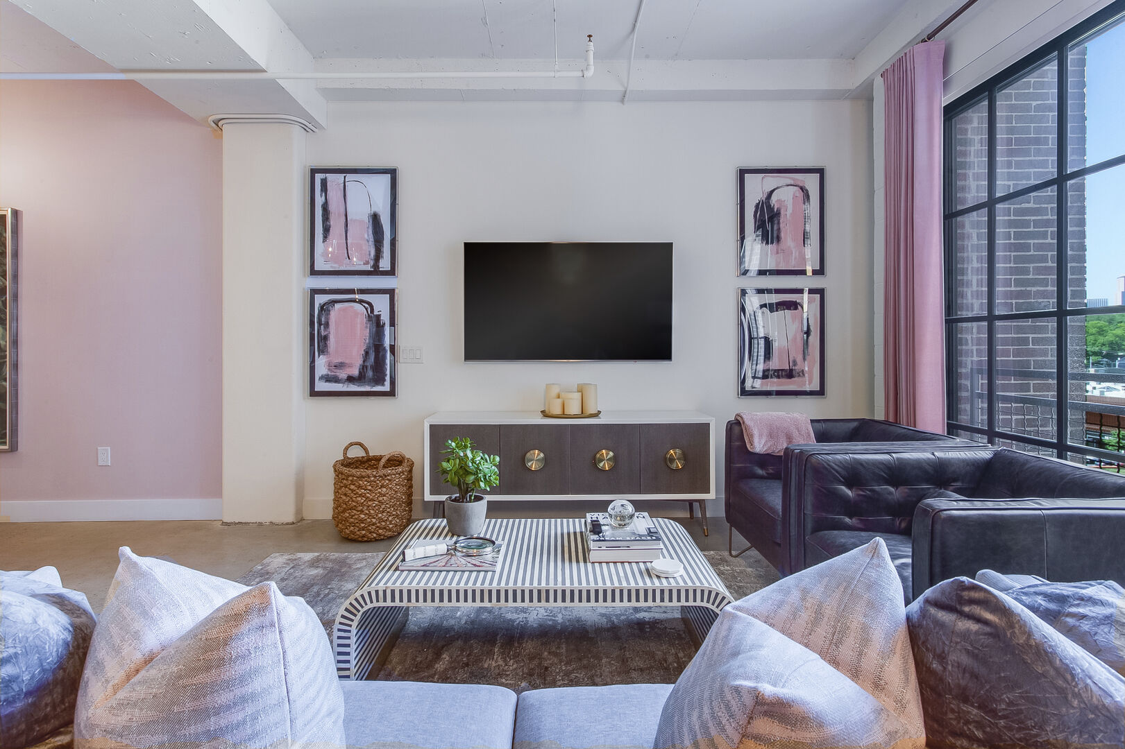 Living Area Includes Large TV and Chic Furnishings.