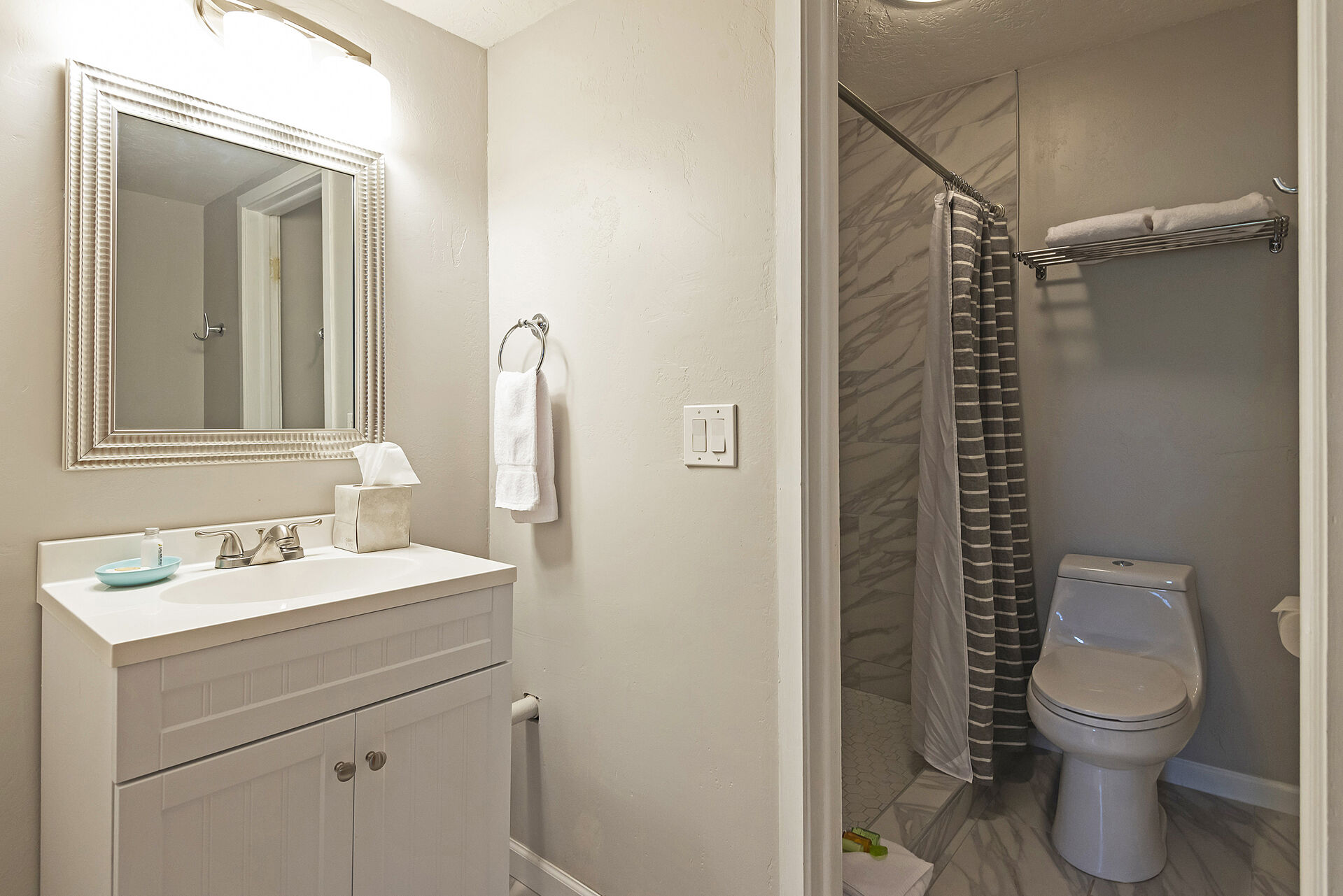 Main Level Full Bath with a Vanity and Separate Shower