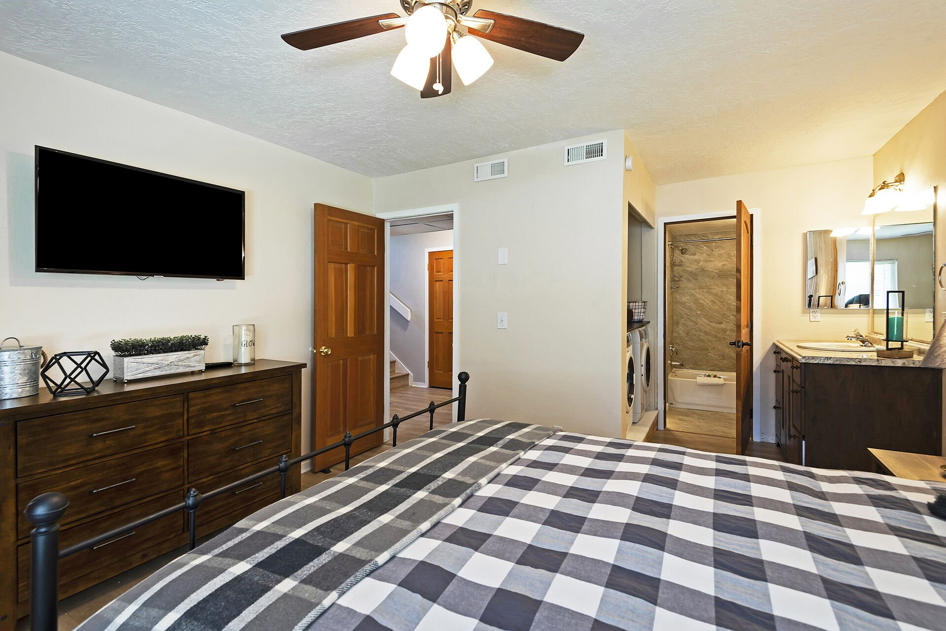 Master Bedroom with a Queen Bed, Smart TV and a Private Vanity