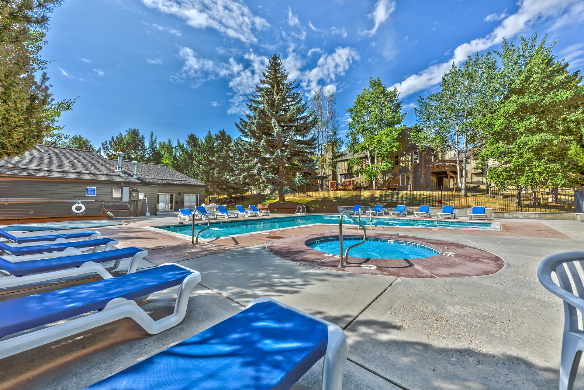 Community Amenities - Clubhouse with a Pool Open in the Summer, a Hot Tub Open Year Round and a Sauna