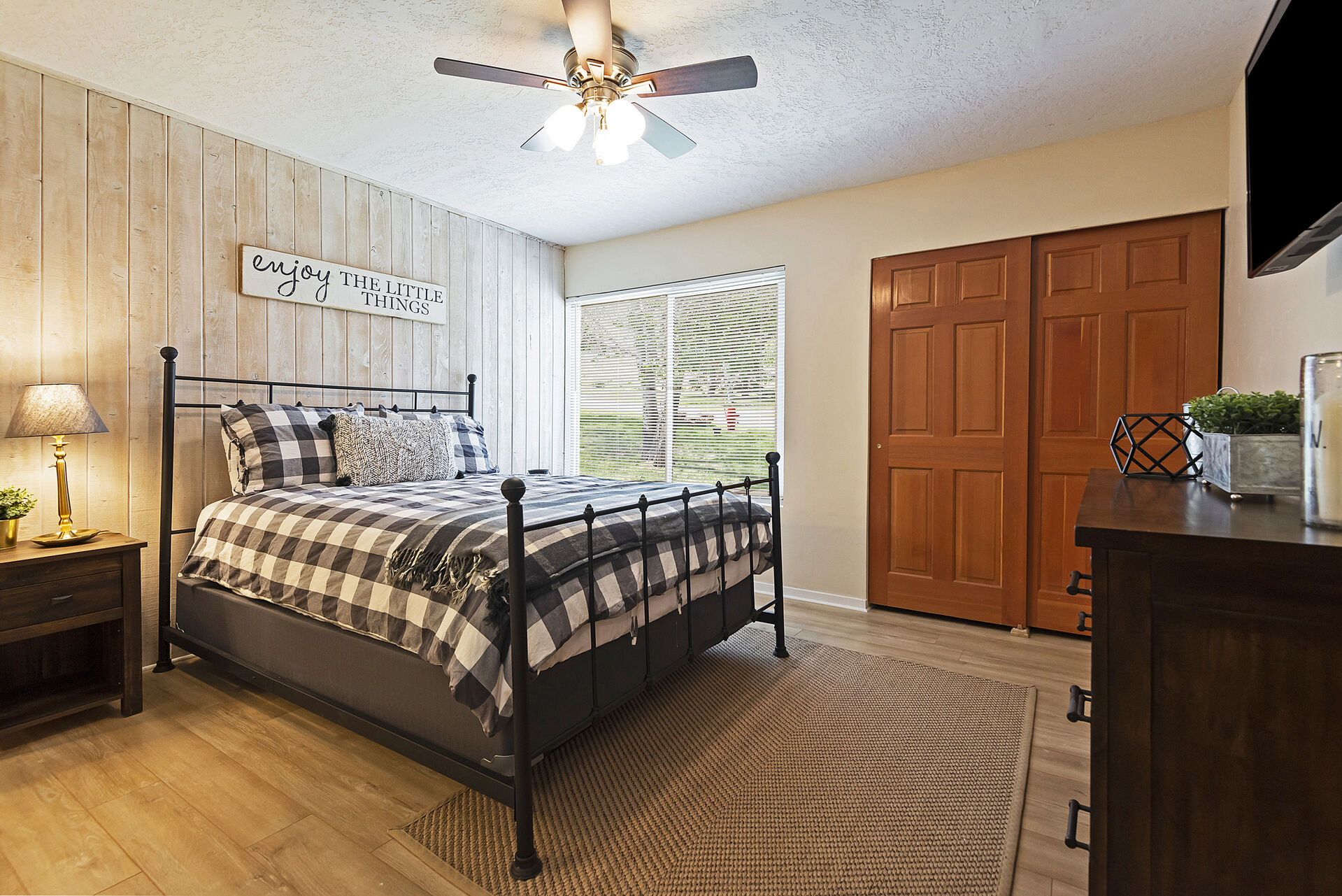 1st Level Master Bedroom with a Queen Bed, a 43