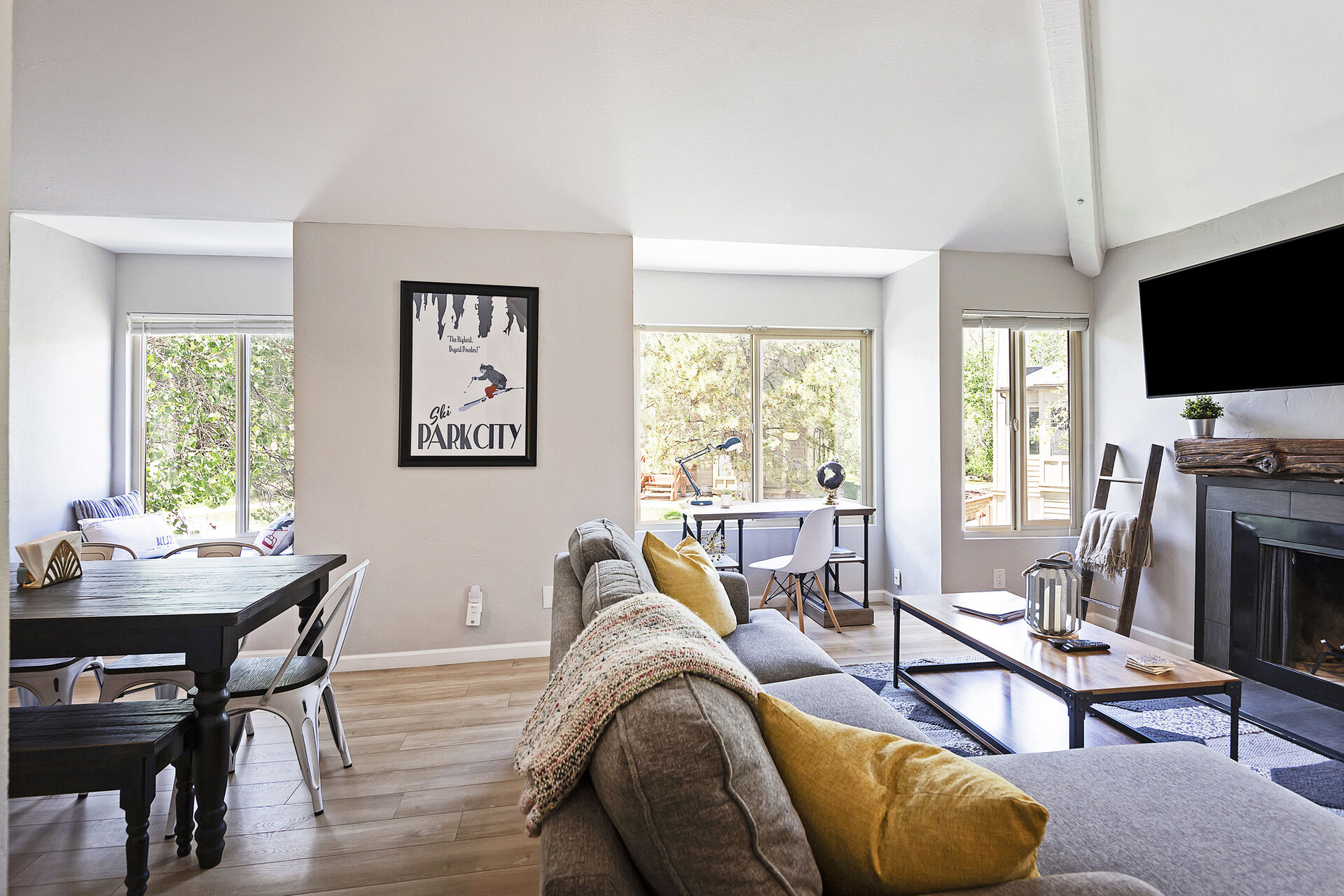 Living Room with Vaulted Ceilings and Plenty of Natural Light