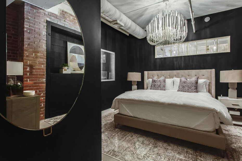 Luxury Bedroom Features Black Walls and Beautiful Furnishings.