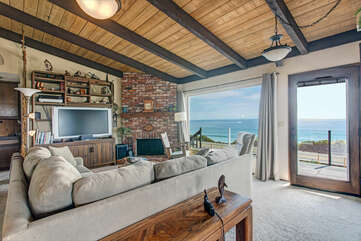 Living room with views of the ocean.