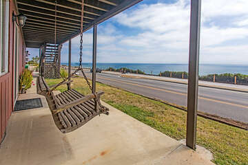 Relax in our downstairs swing with view of the ocean.