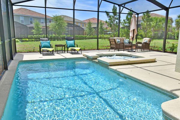 Sparkling pool with sun loungers and informal seating