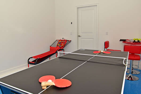 Garage converted to games room with ping pong/air hockey table and skee ball game.  Tennis rackets available.