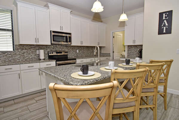 Kitchen with breakfast bar seating 4