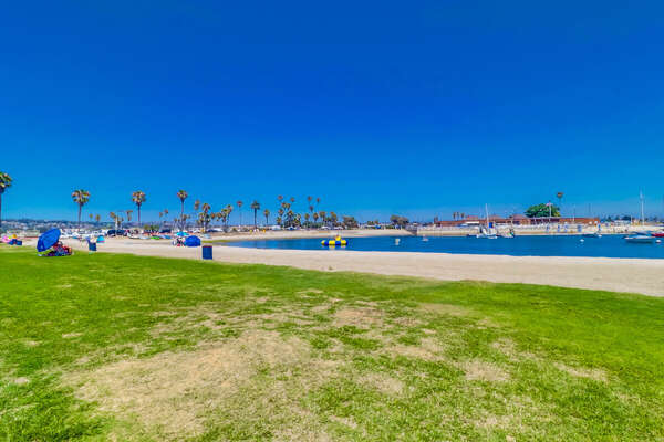 Bayfront beach with grassy area
