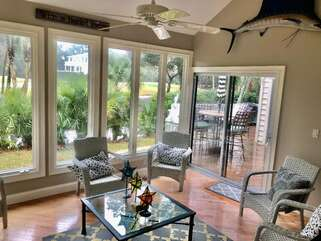 Large sun room with ceiling fan
