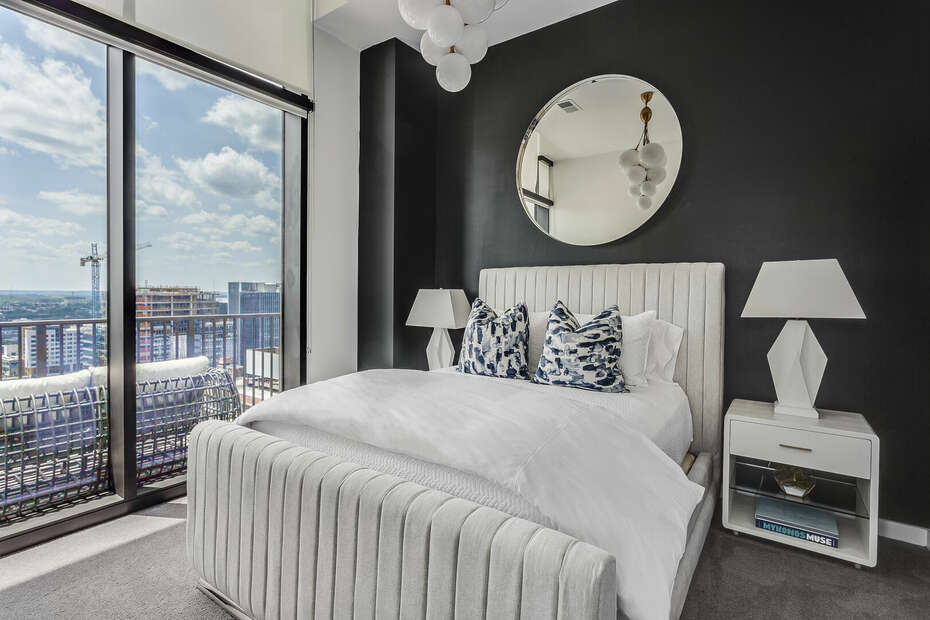 Guest Bedroom Includes Bed, Two Side Tables, and Stunning Views.