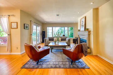 The comfortable living room includes a fireplace and French doors to the deck