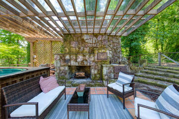 Share a drink in the evening around the outdoor fireplace