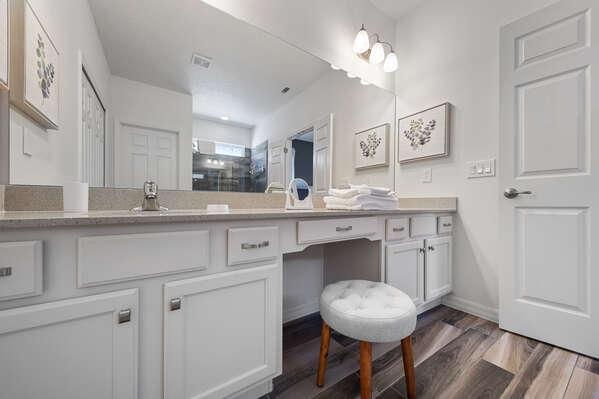 Comfortable vanity chair and large mirror vanity