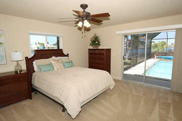Queen Guest Bedroom 3. Flat screen TV and access to lanai