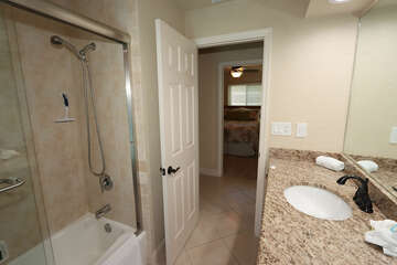 Guest bathroom and access to lanai