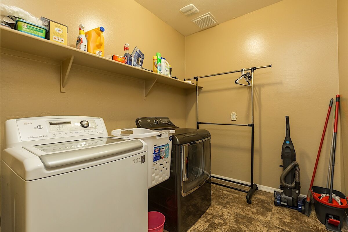 Inside laundry with full size washer and dryer