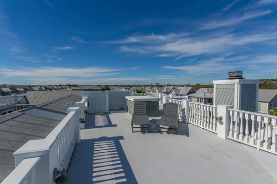 Spacious Rooftop Features Two Lounge Chairs.
