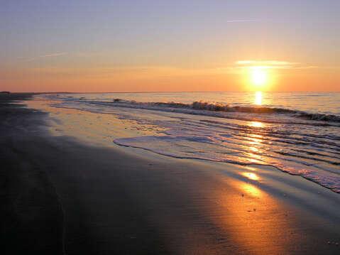 Experience a Sunset on the Beach.