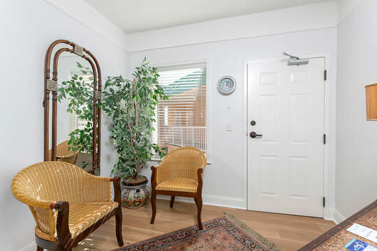 Entryway with Armchairs, Mirror, and the Door.