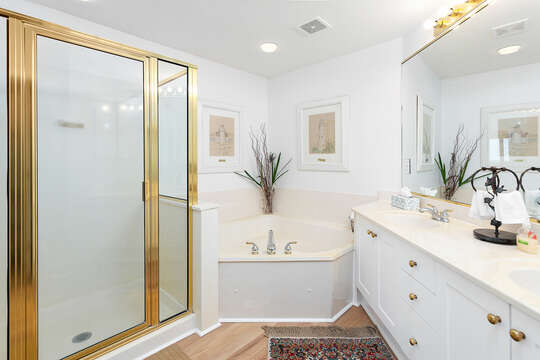 Double Vanity Sink, Bathtub, Walk-In Shower, and Mirror.