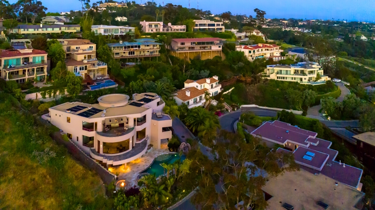 Located high on the hill above La Jolla Country Club this 10,000 square foot Villa is a paradise on its own.