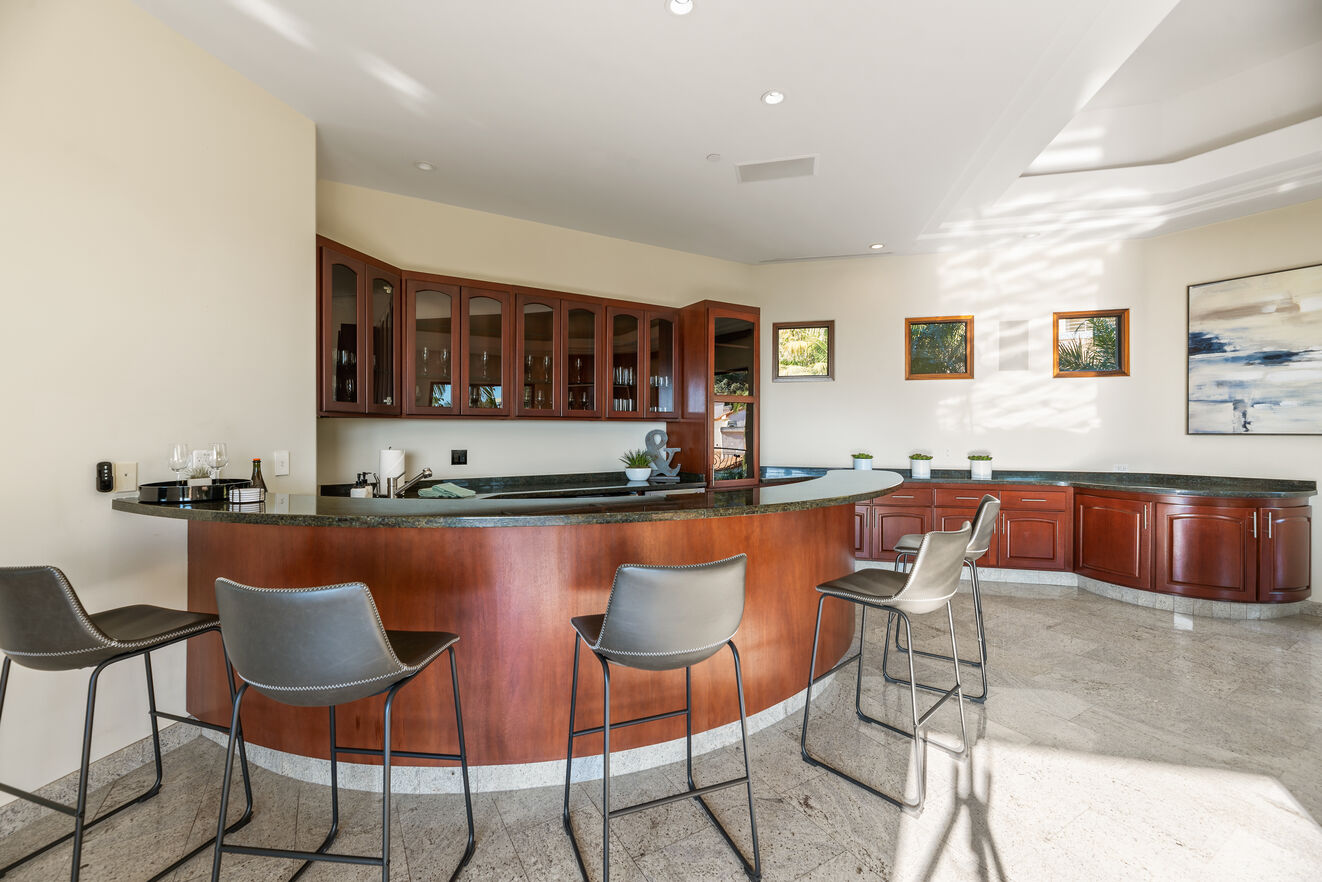 Mid level full bar with wine cooler, refrigerator, bar sink and more