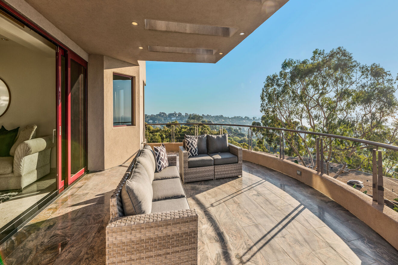 Upstairs  balcony with outdoor sofa seating and the best views of the house.
