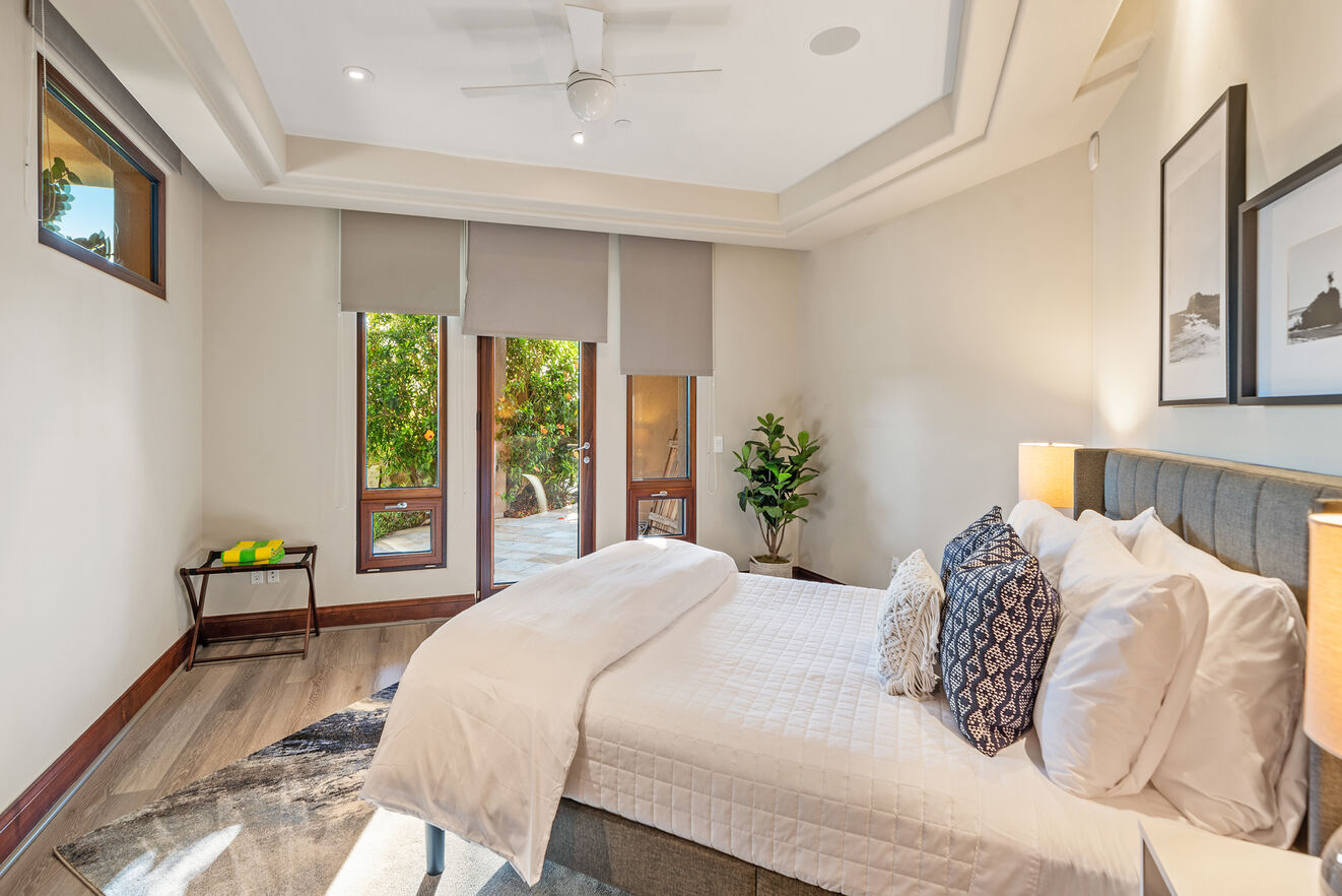 Bedroom 6 - Downstairs with Queen size bed,  patio/pool access, walk in closet, ensuite bathroom with shower