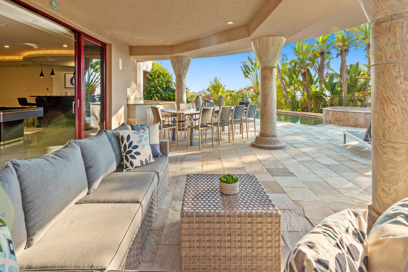 Step outside with a drink from the downstairs bar and lounge out by the pool, hot tub, fire pit and outdoor kitchen with dining for 12
