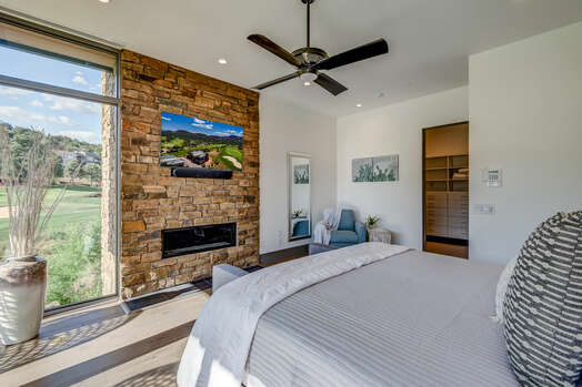 Master Bedroom with a Gas Fireplace, 55