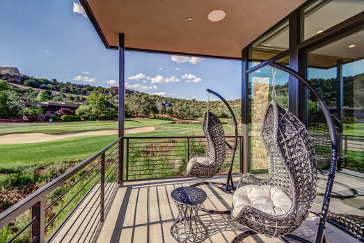 Private Deck off the Master Bedroom with Hanging Chairs and Exquisite Views