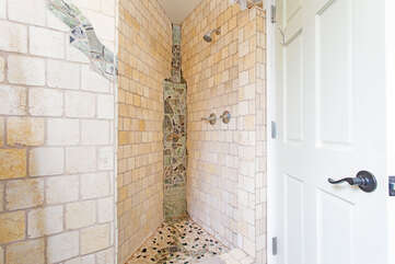 Downstairs bathroom shower with customized tile.