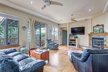 Living room and open deck area.Living has a Smart TV.
